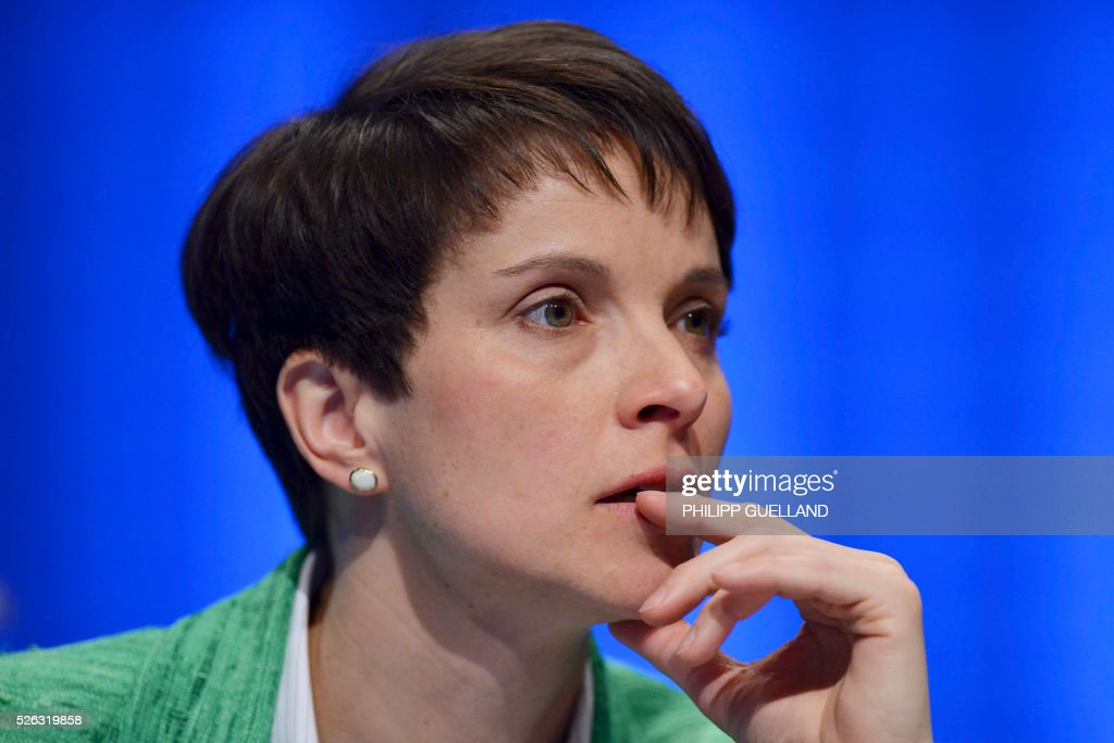 Head of AFD, Frauke Petry talks attends a party congress of the German right wing party AfD (Alternative fuer Deutschland) at the Stuttgart Congress Centre ICS on April 30, 2016 in Stuttgart, southern Germany. The Alternative for Germany (AfD) party is meeting in the western city of Stuttgart, where it is expected to adopt an anti-Islamic manifesto, emboldened by the rise of European anti-migrant groups like Austria's Freedom Party. / AFP / Philipp GUELLAND