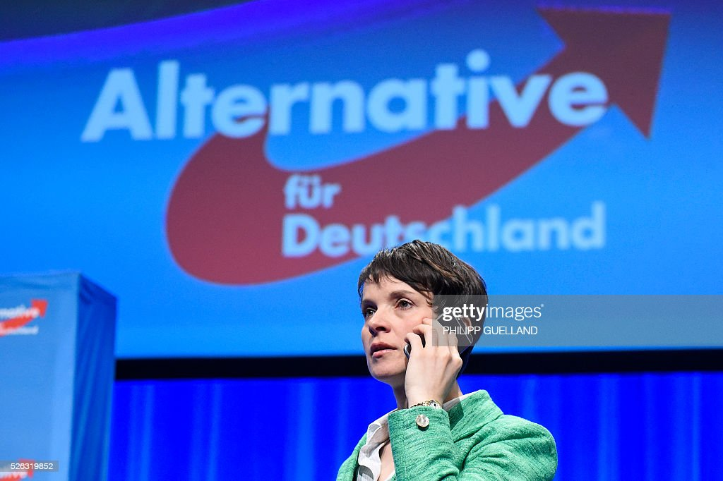 Head of AFD, Frauke Petry talks on the phone during a party congress of the German right wing party AfD (Alternative fuer Deutschland) at the Stuttgart Congress Centre ICS on April 30, 2016 in Stuttgart, southern Germany. The Alternative for Germany (AfD) party is meeting in the western city of Stuttgart, where it is expected to adopt an anti-Islamic manifesto, emboldened by the rise of European anti-migrant groups like Austria's Freedom Party. / AFP / Philipp GUELLAND