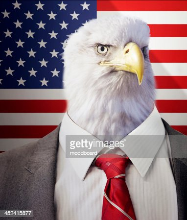 Head of an eagle on a businessman's body in front of  Stars and Stripes flag : Stock-Foto