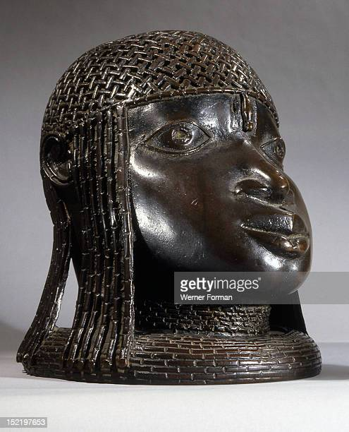 A head of an Oba from an ancestral shrineThe head has a low coral collar and a beaded cap Nigeria Edo Benin