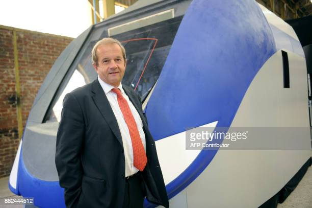 Head of Bombardier Transportation in France Jean Berge is pictured in front of a giant model of the Regio 2N regional doubledeck train developed for...