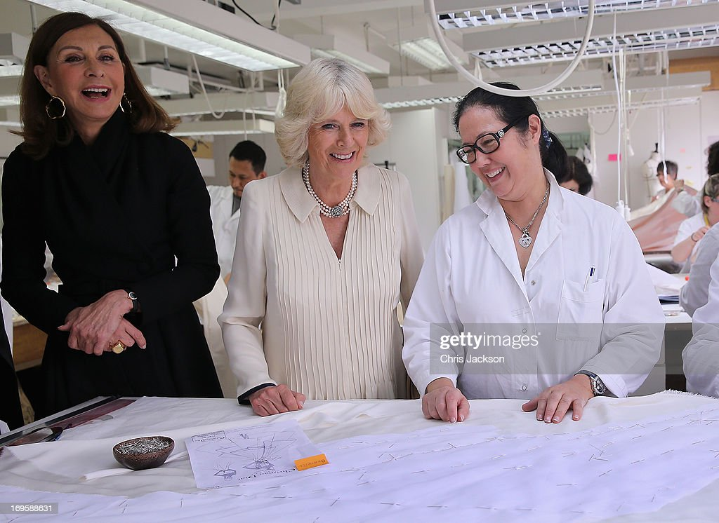 Head of Dior Couture, Catheine Riviere (L) looks on as <a gi-track='captionPersonalityLinkClicked' href=/galleries/search?phrase=Camilla+-+Duchess+of+Cornwall&family=editorial&specificpeople=158157 ng-click='$event.stopPropagation()'>Camilla</a>, Duchess of Cornwall visits the workshop at the headquarters of Dior on May 28, 2013 in Paris France. <a gi-track='captionPersonalityLinkClicked' href=/galleries/search?phrase=Camilla+-+Duchess+of+Cornwall&family=editorial&specificpeople=158157 ng-click='$event.stopPropagation()'>Camilla</a> is on her first overseas solo engagement for a two day visit to Paris in support of the homeless charity EMMAUS of which she is patron.