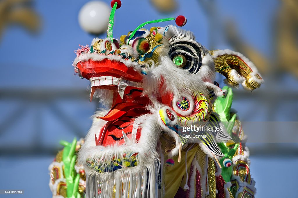 Head of Dragon dancer at Chinese New Year parade : Stock Photo