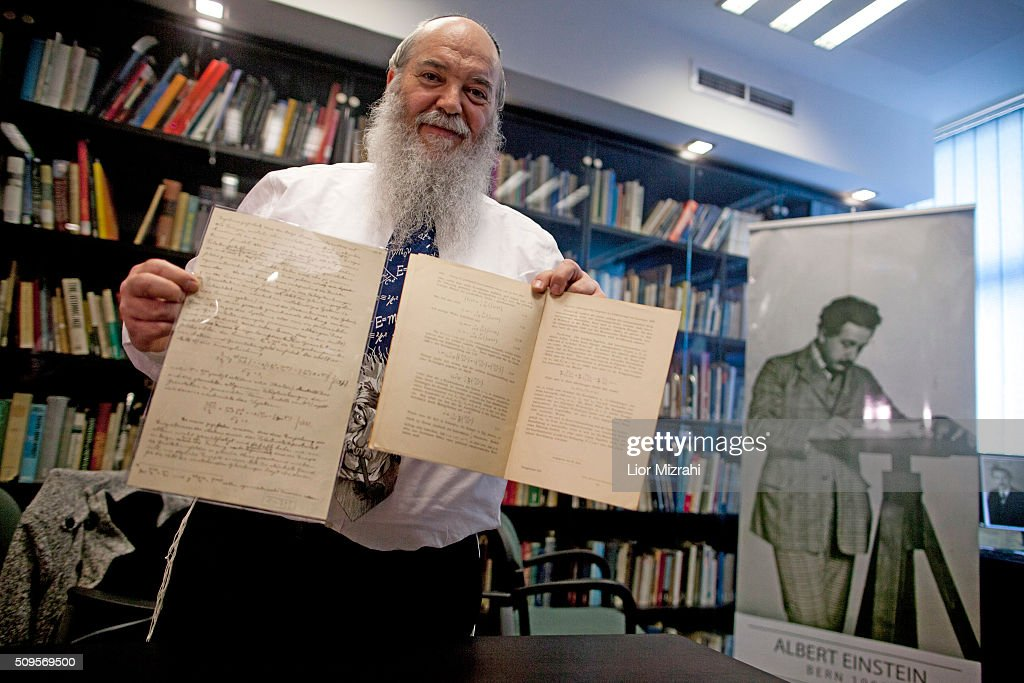 Head of Einstein Archives Dr. Roni Gross of the Hebrew University presents the original 100 years old documents of Albert Einstein's prediction of the existence of gravitational waves at the Albert Einstein Archives of the Hebrew University on February 11, 2016 in Jerusalem, Israel. This year marks the 100th anniversary of the first publication of Einstein's prediction of the existence of gravitational waves. A group of scientists has recently announced that they have finally discovered evidence of the existence of the waves.