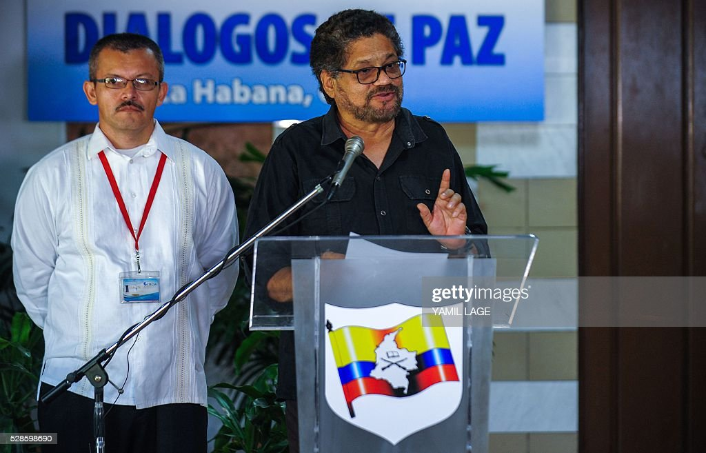 Head of FARC-EP leftist guerrillas delegation, Commander Ivan Marquez (R)reads a statement at Convention Palace in Havana during the peace talks with the Colombian government, on May 6, 2016. At left Yuri Camargo. / AFP / YAMIL
