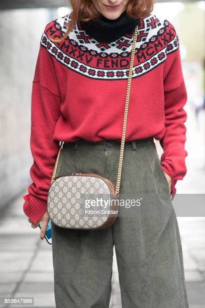 Head of fashion at Italian Grazia Sara Moscini wears a Fendi sweater Gucci bag and Twins Florence trousers on day 2 of London Womens Fashion Week...