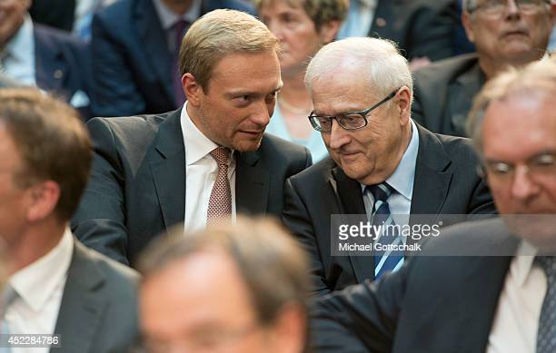 Head of FDP Christian Lindner and former Head of FDP Rainer Bruederle attend a reception on occasion of German Chancellor Angela Merkel's 60th...