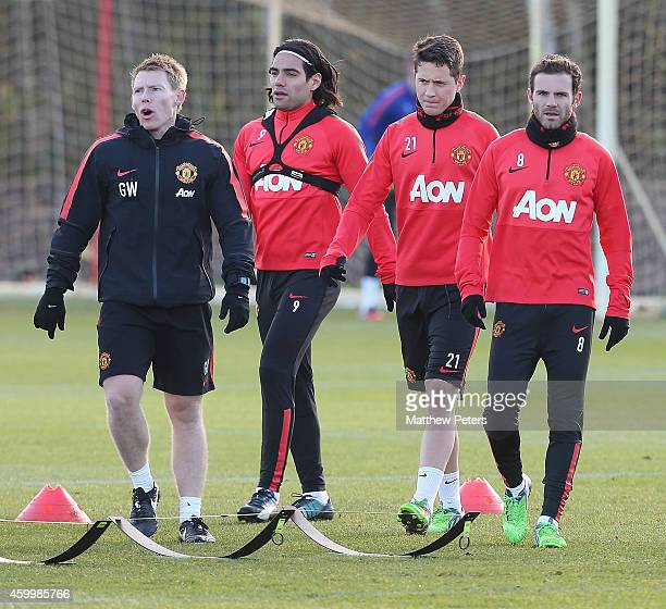Head of Fitness Gary Walker Radamel Falcao Ander Herrera and Juan Mata of Manchester United in action during a first team training session at Aon...
