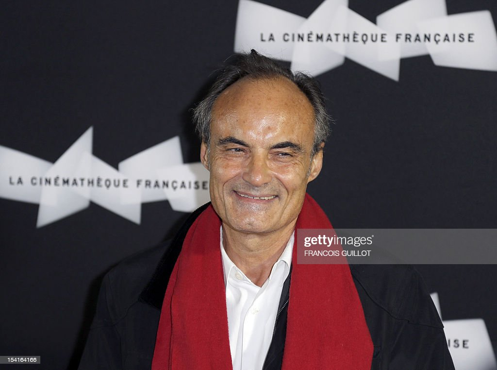 Head of France Inter Radio station Philippe Val poses during a photocall prior to the premiere screening of the movie 'Amour', awarded the 2012 Cannes film festival Palme d'Or, on October 15, 2012 in Paris.