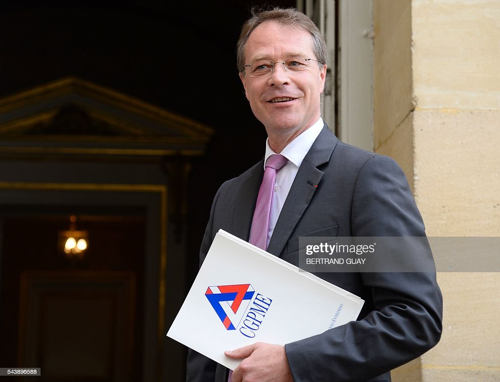 Head of France's small and medium-sized employers' organisation (CGPME), Francois Asselin arrives for a meeting with the French prime minister and the French Labour minister on June 30, 2016 at the Hotel Matignon in Paris. French President Francois Hollande said last week that his Socialist government would 'go all the way' to enact the labour reforms, which are seen by critics as too pro-business and a threat to cherished workers' rights. / AFP / BERTRAND