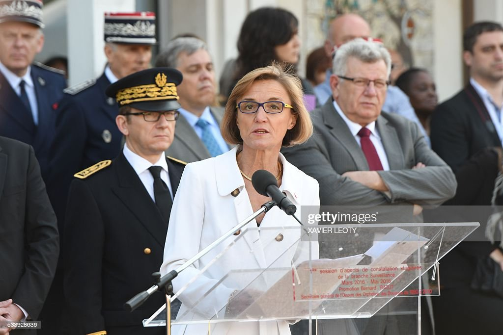 Head of French customs Helene Crocquevieille (C), flanked by French Junior Budget Minister Christian Eckert (R), delivers a speech during the closing ceremony for the graduated class of the National School of Customs in La Rochelle on May 24, 2016. French customs services received a new training to fight against terrorism, the first 'agents of observation' of customs recruited as part of the security agreement to reinforce the numbers of judiciary, penitentiary and customs police and gendarme members. As part of this security agreement and concerning only the customs service 1,000 new positions will be created between 2016 and 2017. / AFP / XAVIER