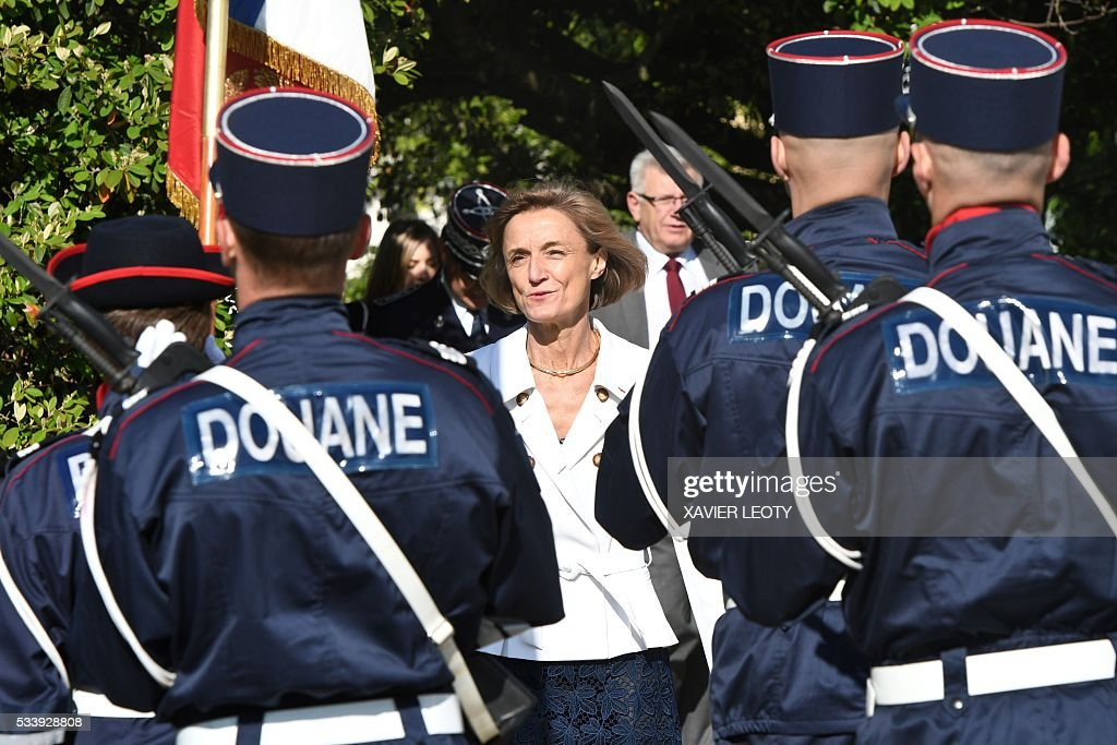Head of French customs Helene Crocquevieille (C) looks on during the closing ceremony for the graduated class of the National School of Customs in La Rochelle on May 24, 2016. French customs services received a new training to fight against terrorism, the first 'agents of observation' of customs recruited as part of the security agreement to reinforce the numbers of judiciary, penitentiary and customs police and gendarme members. As part of this security agreement and concerning only the customs service 1,000 new positions will be created between 2016 and 2017. / AFP / XAVIER