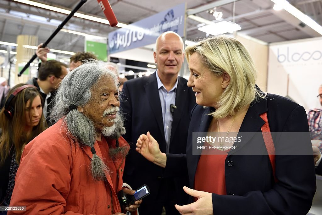 Head of French far-right party Front National (FN) Marine Le Pen (C) visits a stand of the 'Concours Lepine' (Lepine contest) at Paris' fair, on May 4, 2016 in Paris. The Lepine contest, a competition for inventors in the world, was launched in 1901 by Louis Lepine, the city's police chief and has chalked up some notable successes, such as the world's first artificial heart in 1937. / AFP / Eric FEFERBERG