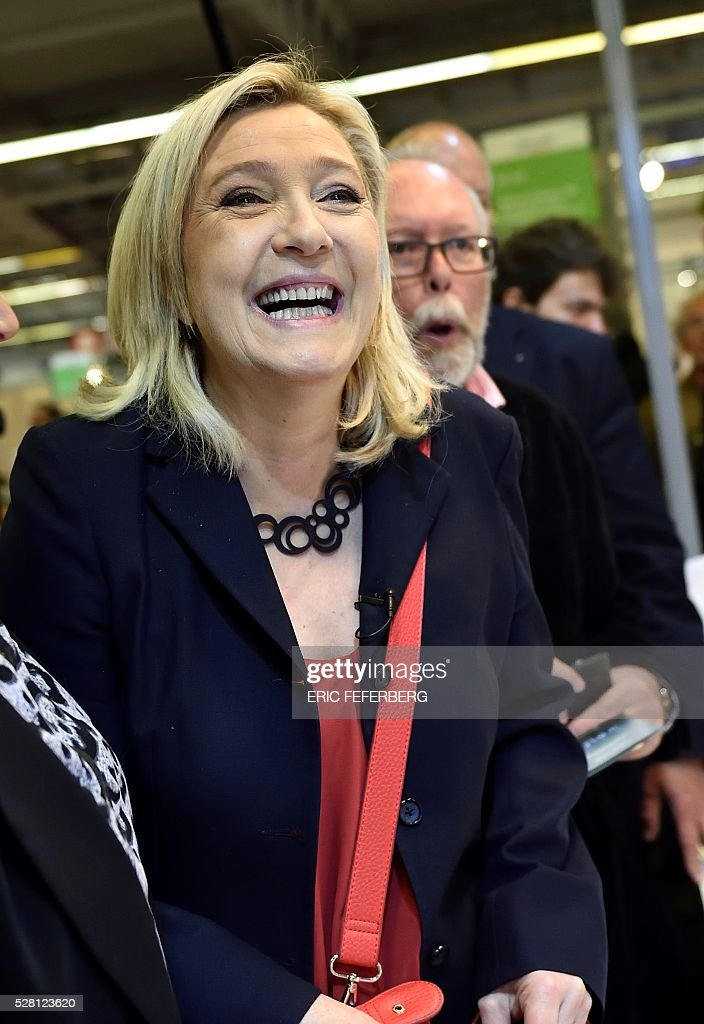 Head of French far-right party Front National (FN) Marine Le Pen visits a stand of the 'Concours Lepine' (Lepine contest) at Paris' fair, on May 4, 2016 in Paris. The Lepine contest, a competition for inventors in the world, was launched in 1901 by Louis Lepine, the city's police chief and has chalked up some notable successes, such as the world's first artificial heart in 1937. / AFP / ERIC