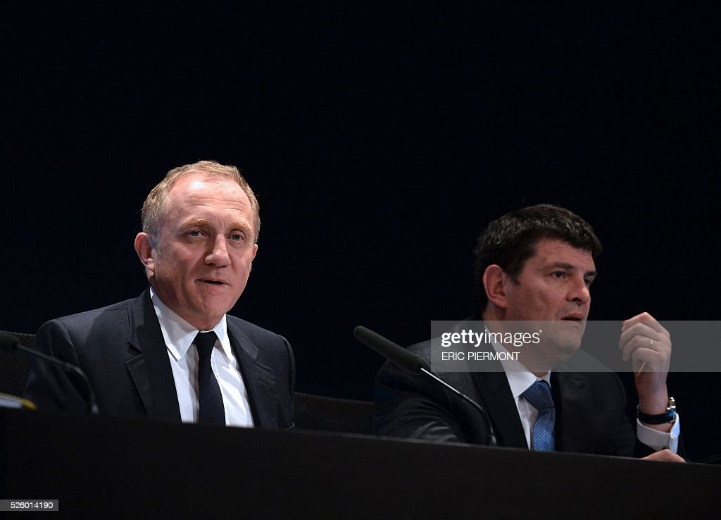 Head of French luxury and sports clothing group Kering, Francois-Henri Pinault (L) and group's managing director Jean-Fran��ois Palus address the group's annual shareholders' meeting in Paris on April 29, 2016. / AFP / ERIC