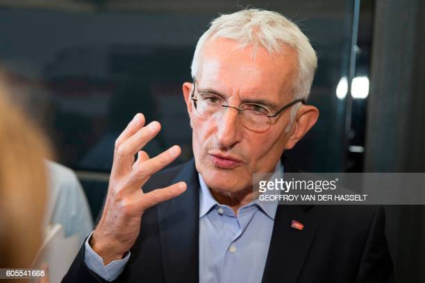 Head of French national stateowned railway company SNCF Guillaume Pepy gestures as he answers journalists during the presentation of the new TGV high...