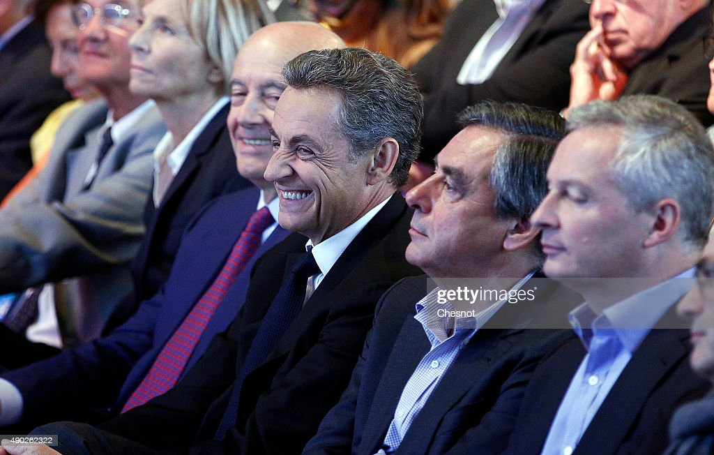 Head of French right-wing party 'Les Republicains' and former President <a gi-track='captionPersonalityLinkClicked' href=/galleries/search?phrase=Nicolas+Sarkozy&family=editorial&specificpeople=211375 ng-click='$event.stopPropagation()'>Nicolas Sarkozy</a> (3rd R), 'Les Republicains' party member and Mayor of Bordeaux <a gi-track='captionPersonalityLinkClicked' href=/galleries/search?phrase=Alain+Juppe&family=editorial&specificpeople=235359 ng-click='$event.stopPropagation()'>Alain Juppe</a> (4th R), 'Les Republicains' party's member and Former French Prime Minister Francois Fillon (2nd R), UDI-MoDem's chief candidate for the Ile de France region and MoDem vice-President <a gi-track='captionPersonalityLinkClicked' href=/galleries/search?phrase=Marielle+de+Sarnez&family=editorial&specificpeople=634936 ng-click='$event.stopPropagation()'>Marielle de Sarnez</a> (5th R) and 'Les Republicains' party member <a gi-track='captionPersonalityLinkClicked' href=/galleries/search?phrase=Bruno+Le+Maire&family=editorial&specificpeople=877418 ng-click='$event.stopPropagation()'>Bruno Le Maire</a> (L) attend a campaign meeting of the 'Les Republicains' candidate for the December regional elections. Valerie Pecresse is the 'Les Republicains' right-wing party's candidate for the December regional elections in Ile-de-France.