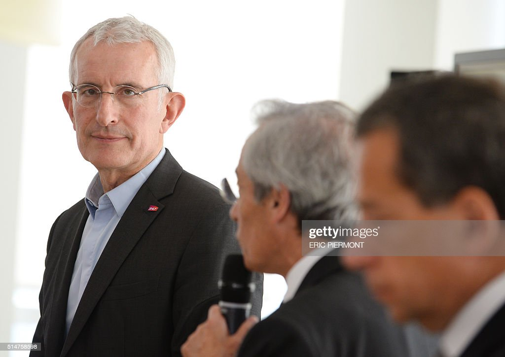 Head of French state owned railway company SNCF Guillaume Pepy listens to chairman of the Supervisory Board Frederic SaintGeours during the...