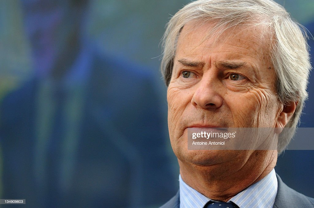 Head of Groupe Bollore, Vincent Bollore whose company is supplying the electric cars, listens at the Autolib electric bluecar launch on December 5, 2011 in Paris, France. Autolib is launching its initial fleet of 250 four-seat grey silent cars today in the French capital after the success of it's bike-rental scheme and hopes to cut both noise and air pollution in the city's streets. (Photo by Antoine Antoniol/Getty Ima
