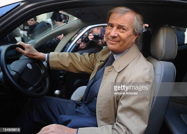 Head of Groupe Bollore Vincent Bollore whose company is supplying the electric cars poses inside an Autolib electric bluecar at the launch on...
