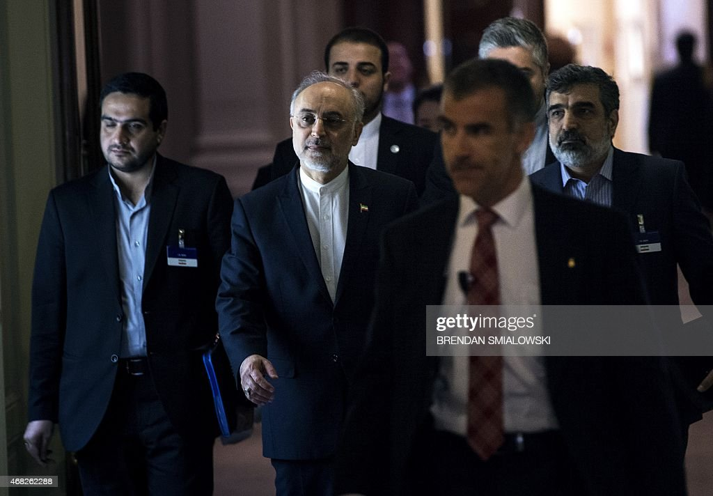 Head of Iranian Atomic Energy Organization Ali Akbar Salehi walks after a meeting at the Beau Rivage Palace Hotel during an extended round of nuclear...