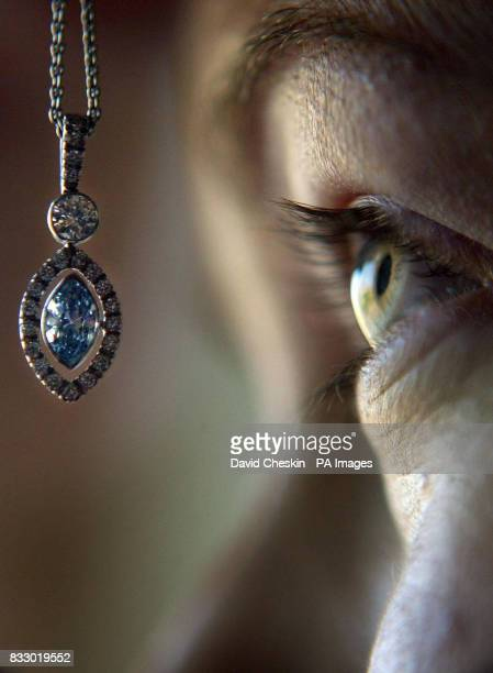 Head of Jewellery Emma McMillian looks at a rare blue diamond necklace worth more than 40 which is to be auctioned off at Lyon and Turnbull in...