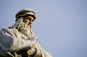 head of Leonardo da Vinci in front of a perfect blue sky
