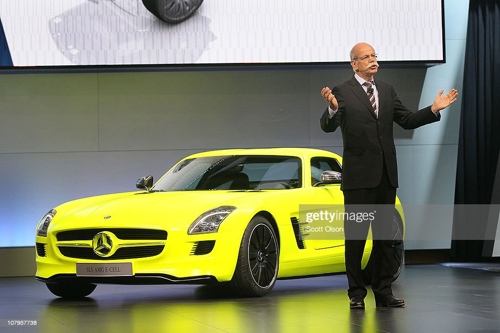 Head of Mercedes-Benz Dr. <a gi-track='captionPersonalityLinkClicked' href=/galleries/search?phrase=Dieter+Zetsche&family=editorial&specificpeople=241297 ng-click='$event.stopPropagation()'>Dieter Zetsche</a> introduces the SLS AMG E-Cell car during the press preview of the North American International Auto Show at the Cobo Center on January 10, 2011 in Detroit, Michigan. The show opened for media previews today and is open to the general public January 15-23.