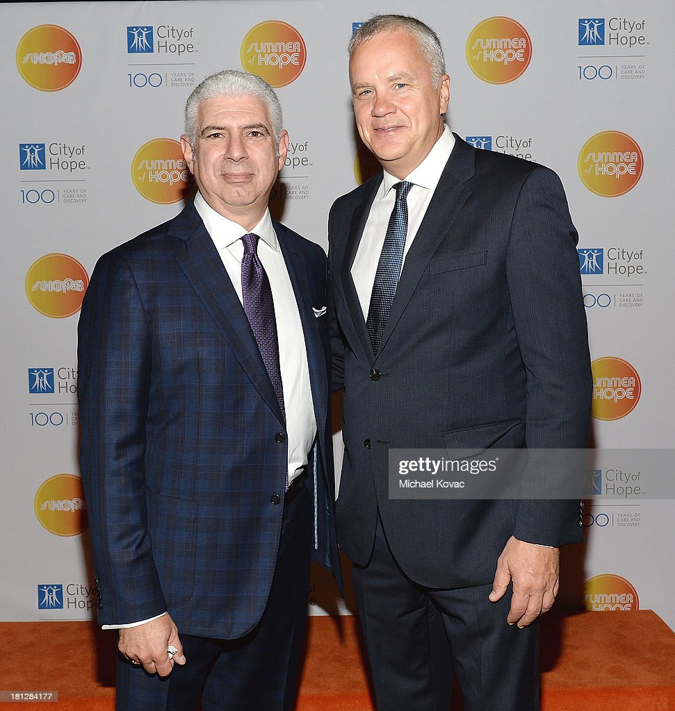 Head of Music Rob Light (L) and actor <a gi-track='captionPersonalityLinkClicked' href=/galleries/search?phrase=Tim+Robbins&family=editorial&specificpeople=182439 ng-click='$event.stopPropagation()'>Tim Robbins</a> attend the City Of Hope Spirit Of Life Gala on September 19, 2013 in Playa Vista, California.