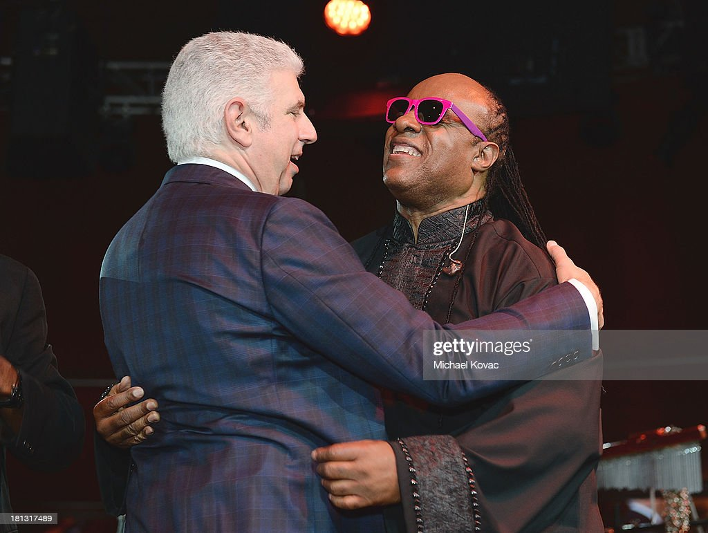 Head of Music Rob Light (L) and singer <a gi-track='captionPersonalityLinkClicked' href=/galleries/search?phrase=Stevie+Wonder&family=editorial&specificpeople=171911 ng-click='$event.stopPropagation()'>Stevie Wonder</a> attend the City Of Hope Spirit Of Life Gala on September 19, 2013 in Playa Vista, California.