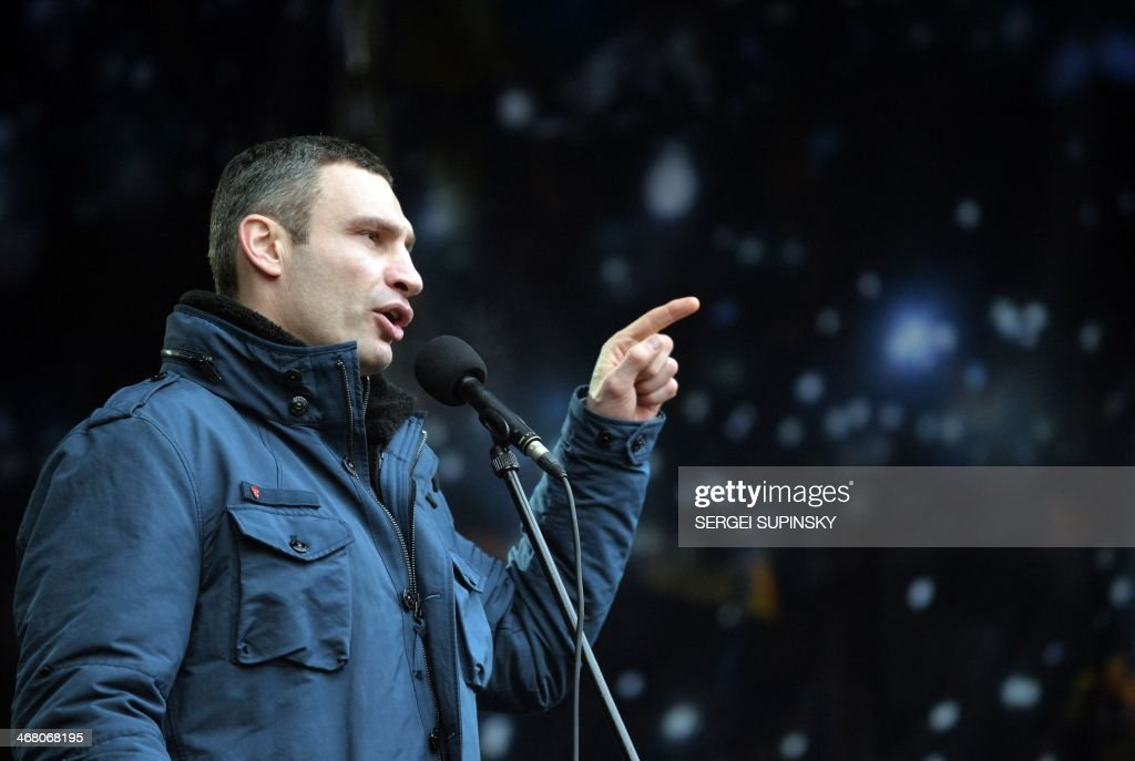 Head of opposition UDAR (Punch) party <a gi-track='captionPersonalityLinkClicked' href=/galleries/search?phrase=Vitali+Klitschko&family=editorial&specificpeople=206402 ng-click='$event.stopPropagation()'>Vitali Klitschko</a> gestures as he speaks during a mass opposition rally on Independence Square in Kiev on February 9, 2014. An estimated 70,000 pro-Western Ukrainians thronged the heart of Kiev on February 9 vowing never to give up their drive to oust President Viktor Yanukovych for his alliance with old master Russia. Wearing blue and yellow ribbons -- the colours of both Ukraine and the European Union -- the crowd sreceived a religious blessing before opposition leaders took to a podium on Independence Square in a bid to ratchet up pressure on Yanukovych to appoint a new pro-Western government. AFP PHOTO/ SERGEI SUPINSKY