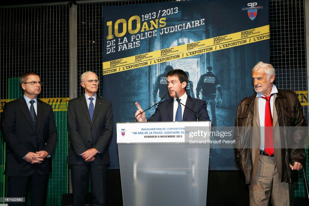 Head of Paris Judicial Police Christian Flaesch, Paris Prefect Bernard Boucault, French Interior Minister <a gi-track='captionPersonalityLinkClicked' href=/galleries/search?phrase=Manuel+Valls&family=editorial&specificpeople=2178864 ng-click='$event.stopPropagation()'>Manuel Valls</a> and legendary actor <a gi-track='captionPersonalityLinkClicked' href=/galleries/search?phrase=Jean-Paul+Belmondo&family=editorial&specificpeople=207029 ng-click='$event.stopPropagation()'>Jean-Paul Belmondo</a> attend the '100th Anniversary Of The Paris Judiciary Police' exhibition opening on November 8, 2013 in Paris, France.