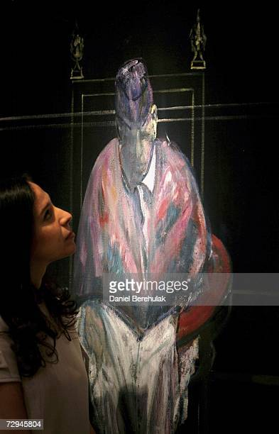Head of Post War and Contemporary Art at Christie's Pilar Ordivas observes Francis Bacon's painting Study for Portrait II 1956 at Christie's Auction...