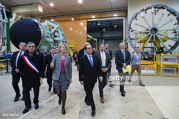 Head of programs at Eurocryospace by Air Liquide and Airbus Safran Launchers Christine Jauffret gives French President Francois Hollande and French...