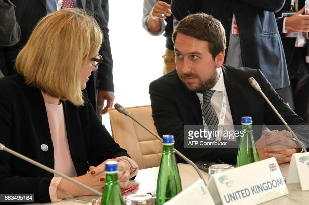 Head of Public Policy and Government for the UK and Israel at Twitter Nick Pickles speaks with Britain's Home Secretary Amber Rudd as they attend...