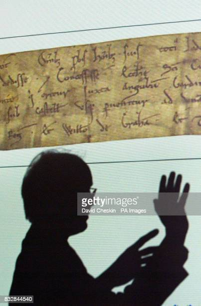 Head of Records David Brown looks at a projection of the 1127 King David Charter as the exhibits from the Dalhousie papers a priceless collection of...