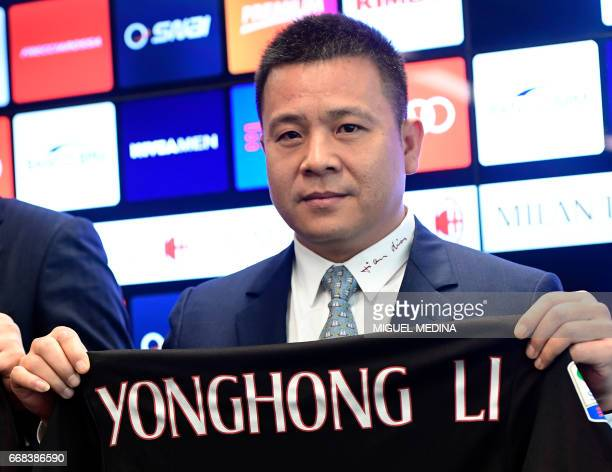 Head of Rossoneri Sport Investment Lux Chinese businessman and new owner of the AC Milan football club Yonghong Li poses with a jersey of the club...
