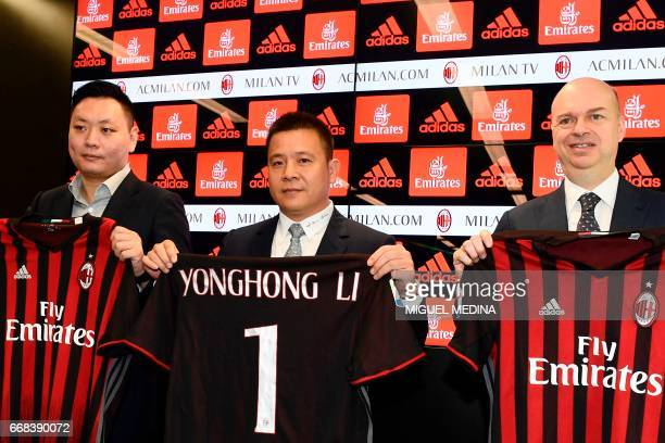 Head of Rossoneri Sport Investment Lux Chinese businessman and new owner of the AC Milan football club Yonghong Li poses with Italian businessman...