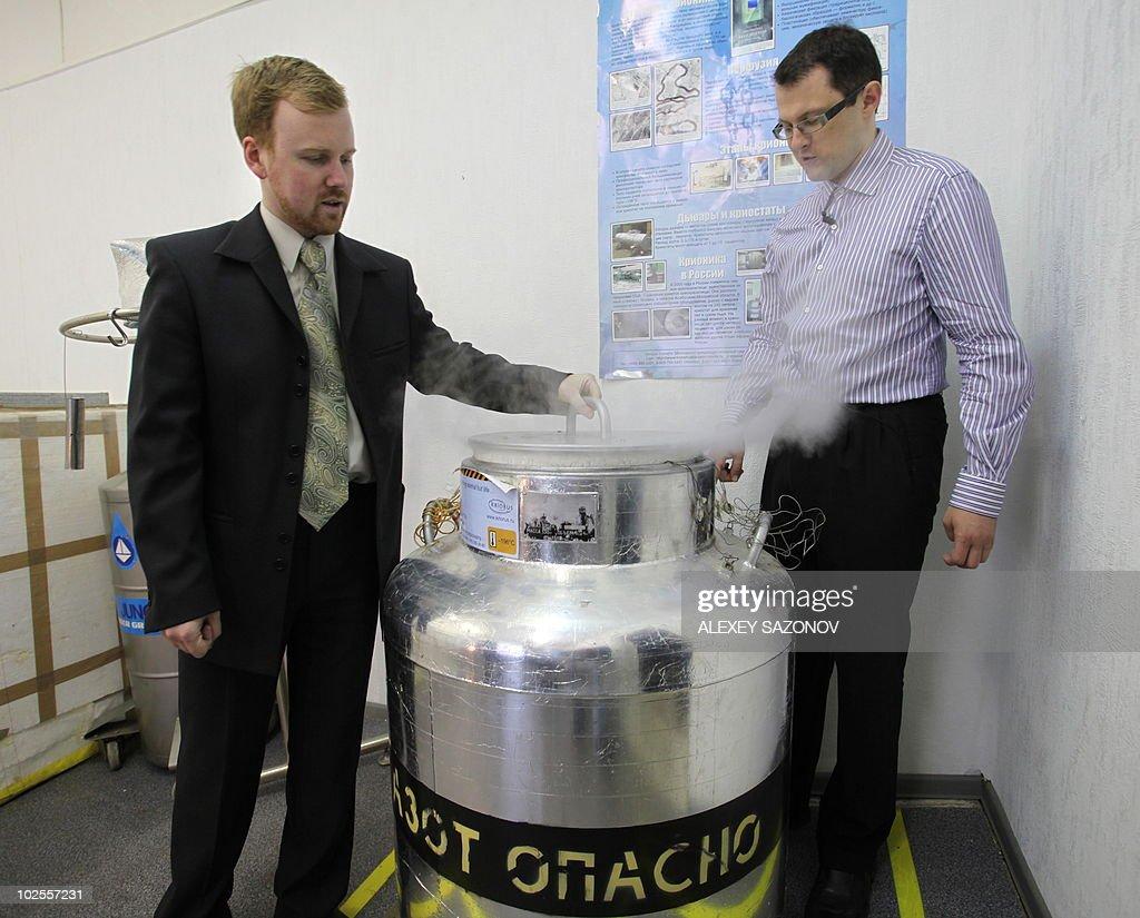 Head of Russian cryonics firm KrioRus Danila Medvedev and KrioRus customer Innokenty Osadchy looks inside a lowtemperature human brain storage unit...