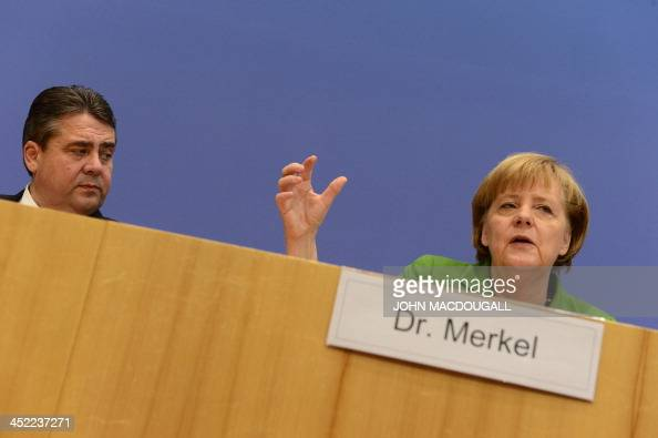 Head of Social Democratic Party Sigmar Gabriel and German Chancellor and head of Christian Democratic Party Angela Merkel are pictured during a press...