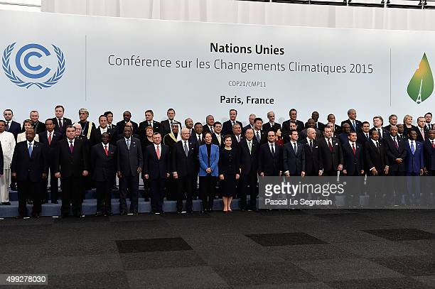 Head of States pose during a family photo session of the Cop 21 on November 30 2015 in Paris France World leaders are meeting in Paris for the start...