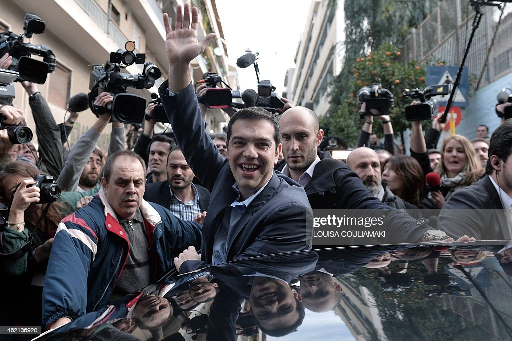 Head of Syriza leftist party <a gi-track='captionPersonalityLinkClicked' href=/galleries/search?phrase=Alexis+Tsipras&family=editorial&specificpeople=6592450 ng-click='$event.stopPropagation()'>Alexis Tsipras</a> greets supporters after casting his vote in a polling station in Athens for Greece's general elections on January 25, 2015. Greece stands on the brink of a make-or-break general election which could sweep the anti-austerity Syriza party to power on Sunday and set the country on a collision course with its international creditors. AFP PHOTO/ Louisa Gouliamaki