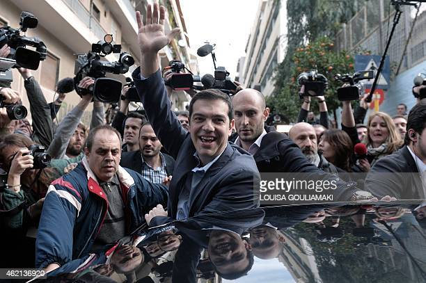 Head of Syriza leftist party Alexis Tsipras greets supporters after casting his vote in a polling station in Athens for Greece's general elections on...