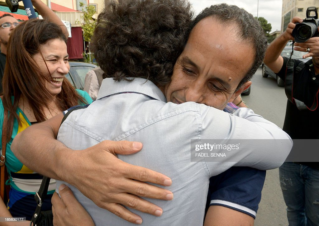 Head of the Arabic version of independent news website Lakome Ali Anouzla (R), hugs a relative after his was freed on bail on October 25, 2013 in the Moroccan city of Rabat. The Moroccan journalist was arrested on September 17, 2013 after his website posted a link to a video attributed to Al-Qaeda in the Islamic Maghreb (AQIM), with the authorities saying he was giving the jihadists a platform.