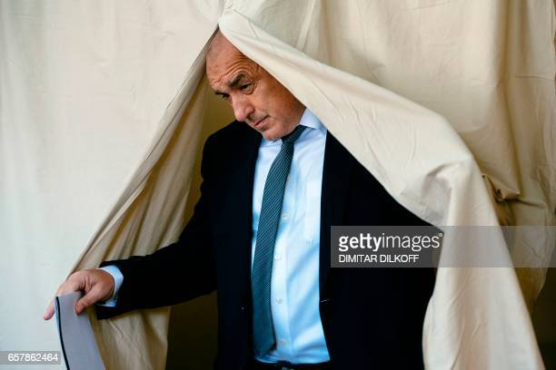 Head of the centreright GERB party and former prime minister Boyko Borisov leaves a voting booth before casting his ballot at a polling station in...