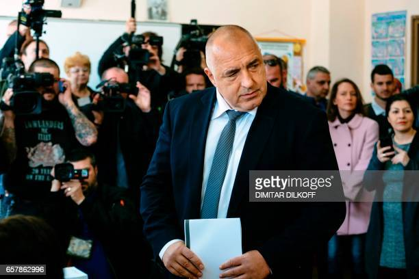 Head of the centreright GERB party and former prime minister Boyko Borisov holds his ballot at a polling station in Sofia on March 26 during the...