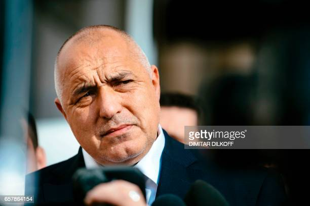 Head of the centreright GERB party and former prime minister Boyko Borisov speaks to journalists at a polling station in Sofia on March 26 during the...