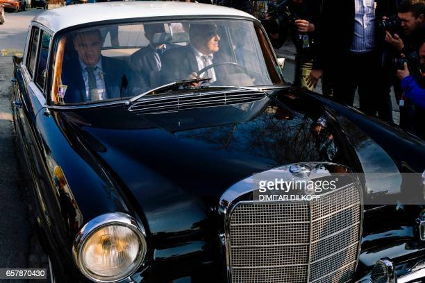 Head of the centreright GERB party and former prime minister Boyko Borisov drives a classic Mercedes Benz after voting at a polling station in Sofia...