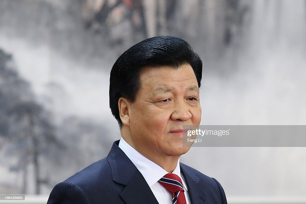 Head of the CPC Propaganda Department <a gi-track='captionPersonalityLinkClicked' href=/galleries/search?phrase=Liu+Yunshan&family=editorial&specificpeople=5623429 ng-click='$event.stopPropagation()'>Liu Yunshan</a>, one of the members of new seven-seat Politburo Standing Committee, greets the media at the Great Hall of the People on November 15, 2012 in Beijing, China. China's ruling Communist Party today revealed the new Politburo Standing Committee after its 18th congress.