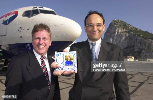 Head of the Crown Agents Stamp Bureau Nigel Fordham officially hands over a record breaking stamp being issued by the Gibraltar Post Office to...